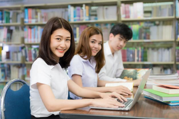 group-happy-asian-students-with-laptop-computer_73503-1261