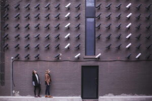 two-person-standing-under-lot-of-bullet-cctv-camera