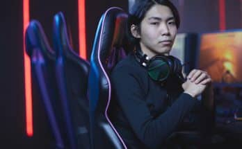 guy with headphones and sat in gaming chair
