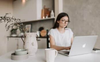 focused-young-businesswoman-working-remotely-at-home-4050327