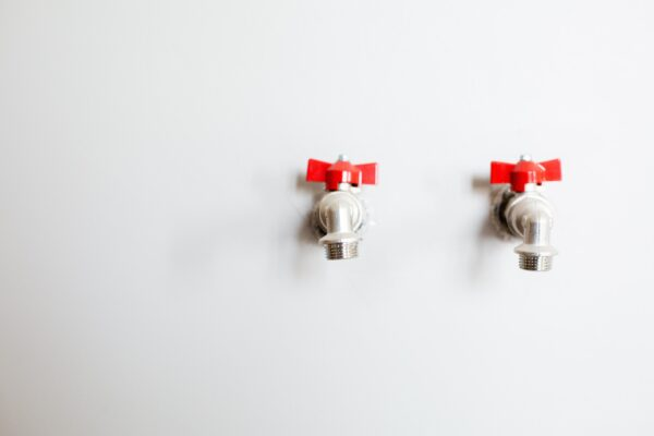 photo-of-faucets-on-white-wall-3616761