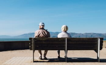 elderly couple sat down on a bench