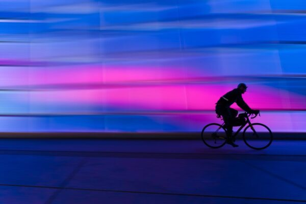 silhouette of person riding on commuter bike