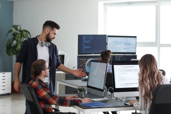 Team of programmers working in office 1