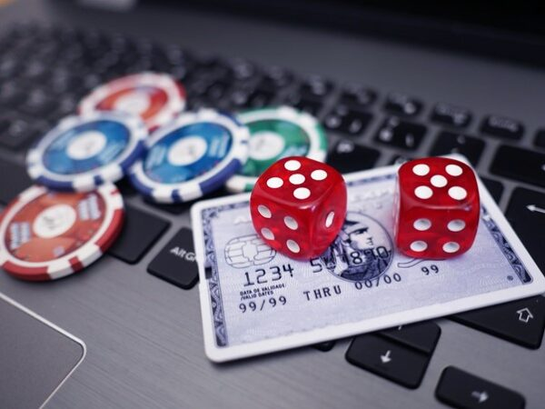 casino-dice-and-chips-with-a-credit-card 1